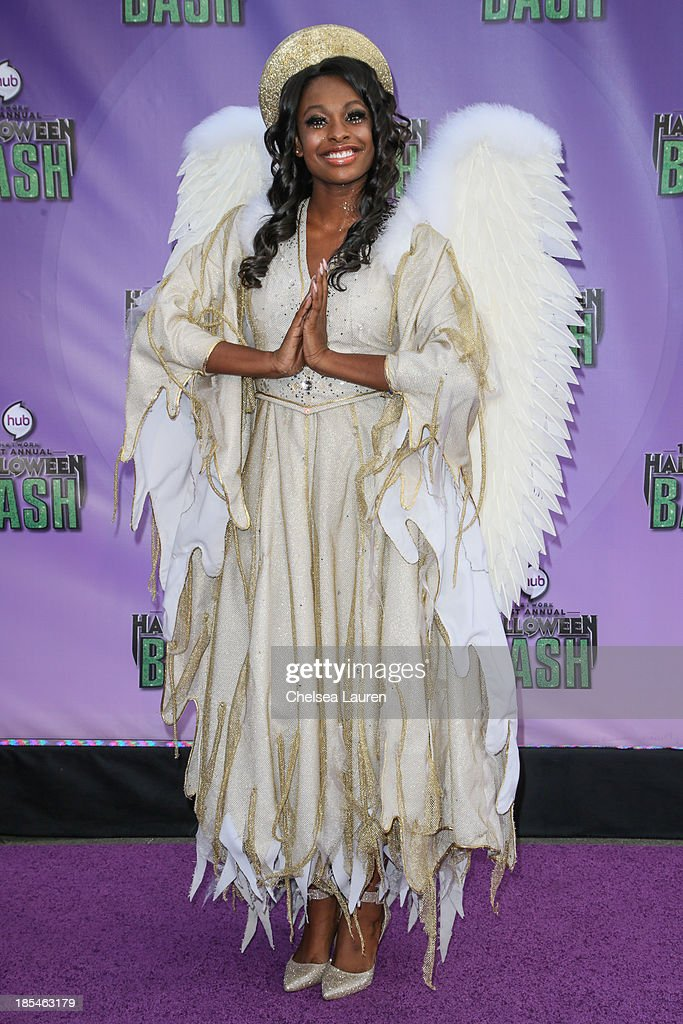 Actress/singer Coco Jones arrives at Hub Network's 1st annual Halloween bash at Barker Hangar on October 20, 2013 in Santa Monica, California.