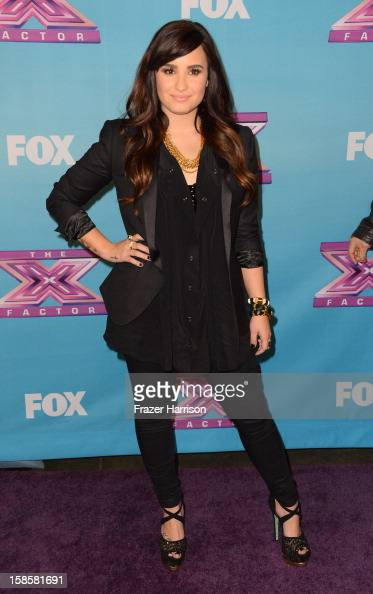 Actress/singer Demi Lovato arrives at Fox's 'The X Factor' Season Finale Night 1 at CBS Television City on December 19 2012 in Los Angeles California