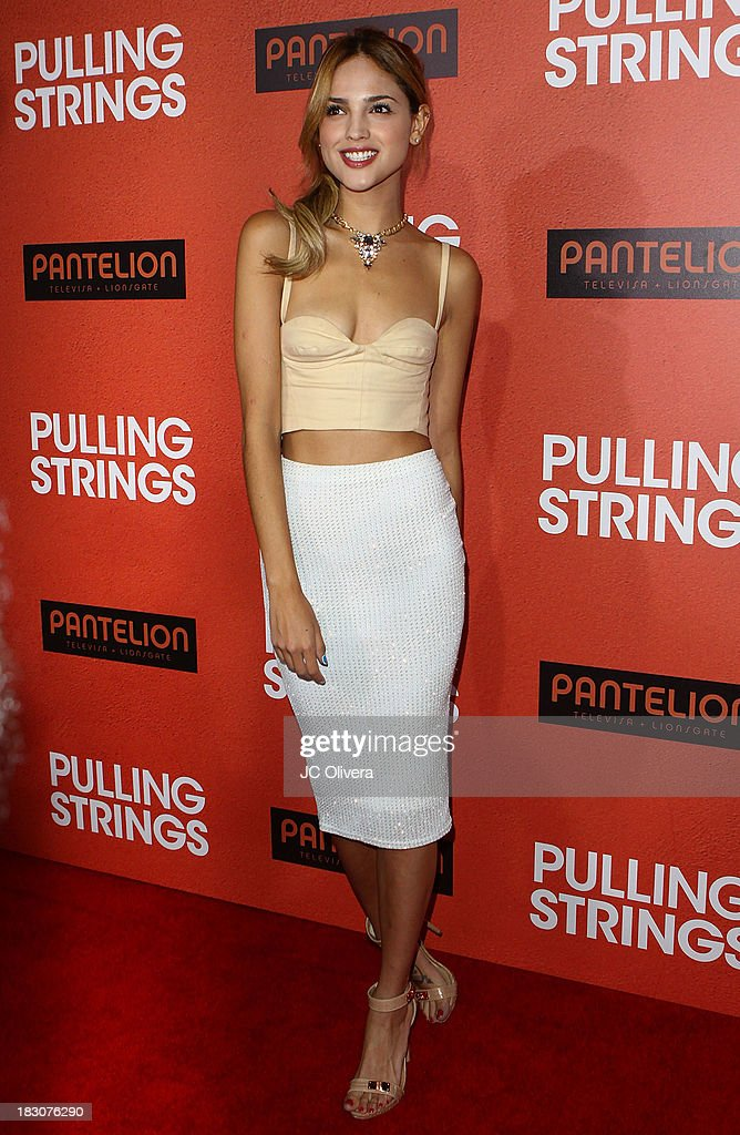 Actress/Singer <a gi-track='captionPersonalityLinkClicked' href=/galleries/search?phrase=Eiza+Gonzalez&family=editorial&specificpeople=5540384 ng-click='$event.stopPropagation()'>Eiza Gonzalez</a> attends the Los Angeles Premiere of 'Pulling Strings' at Regal Cinemas L.A. Live on October 3, 2013 in Los Angeles, California.