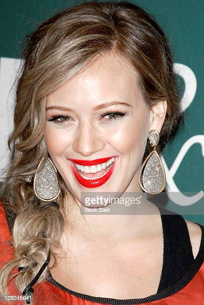 Actress/singer Hilary Duff arrives to sign copies of her new book 'Devoted' at Barnes Noble bookstore at The Grove on October 14 2011 in Los Angeles...
