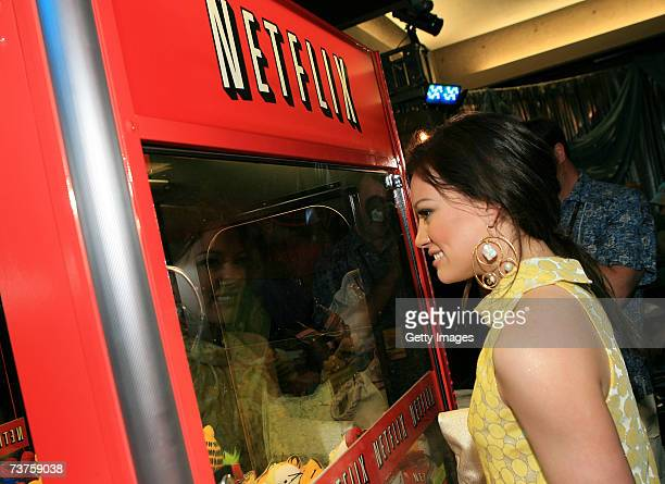 Actress/singer Hilary Duff plays with the Netflix claw machine in the Distinctive Assets gift lounge during the 20th annual Kid's Choice Awards at...