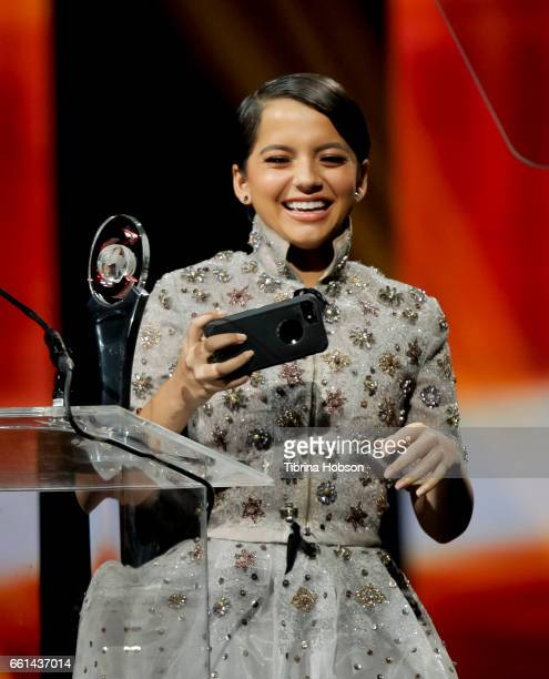 Actress/singer Isabela Moner recipient of the Rising Star of the Year Award takes a selfie onstage at the CinemaCon Big Screen Achievement Awards at...