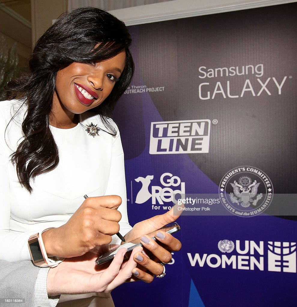 Actress-singer <a gi-track='captionPersonalityLinkClicked' href=/galleries/search?phrase=Jennifer+Hudson&family=editorial&specificpeople=234833 ng-click='$event.stopPropagation()'>Jennifer Hudson</a> signs photo for Samsung's Signatures for Good on the Samsung Galaxy Note 3 at Variety's 5th Annual Power of Women event presented by Lifetime at the Beverly Wilshire Four Seasons Hotel on October 4, 2013 in Beverly Hills, California.