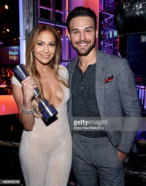 Actresssinger Jennifer Lopez and actor Ryan Guzman pose with the Triple Threat award backstage during the PEOPLE Magazine Awards at The Beverly...