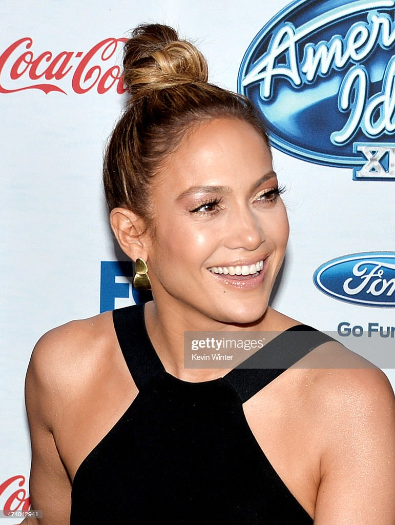 Actress/singer <a gi-track='captionPersonalityLinkClicked' href=/galleries/search?phrase=Jennifer+Lopez&family=editorial&specificpeople=201784 ng-click='$event.stopPropagation()'>Jennifer Lopez</a> arrives at Fox's 'American Idol Xlll' Finalists Party at Fig and Olive on February 20, 2014 in West Hollywood, California.
