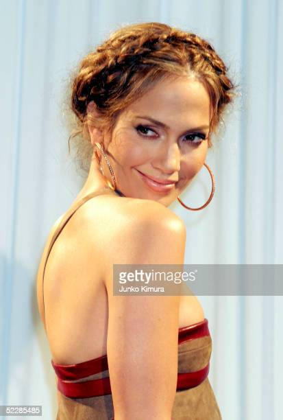 Actress/singer Jennifer Lopez poses for photographers during a press conference on March 7 2005 in Tokyo Japan Lopez is in Japan to promote her new...