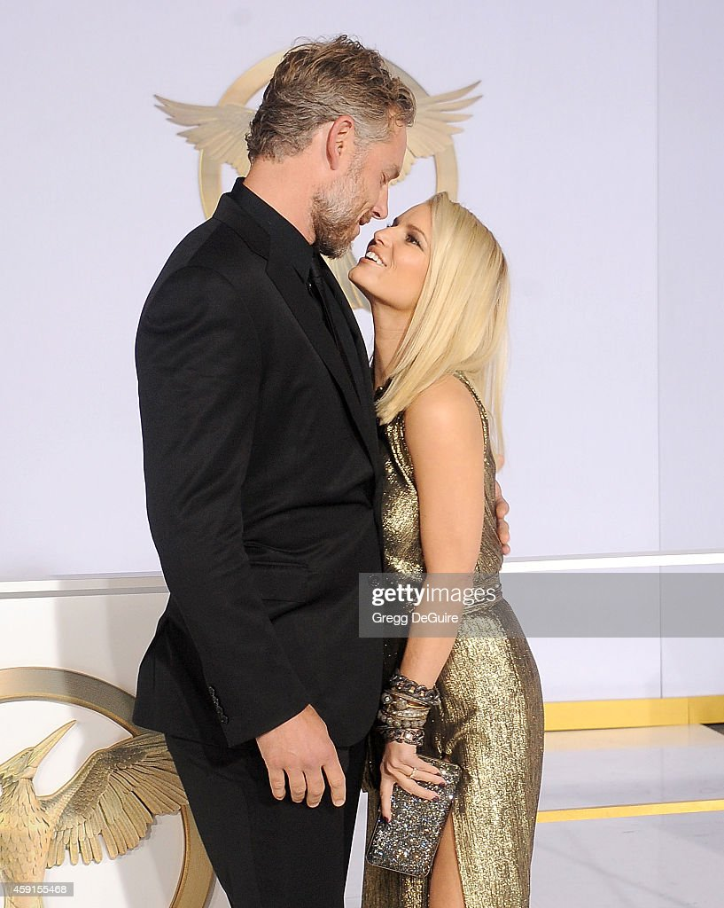 Actress/singer Jessica Simpson and husband Eric Johnson arrive at the Los Angeles premiere of 'The Hunger Games Mockingjay Part 1' at Nokia Theatre...