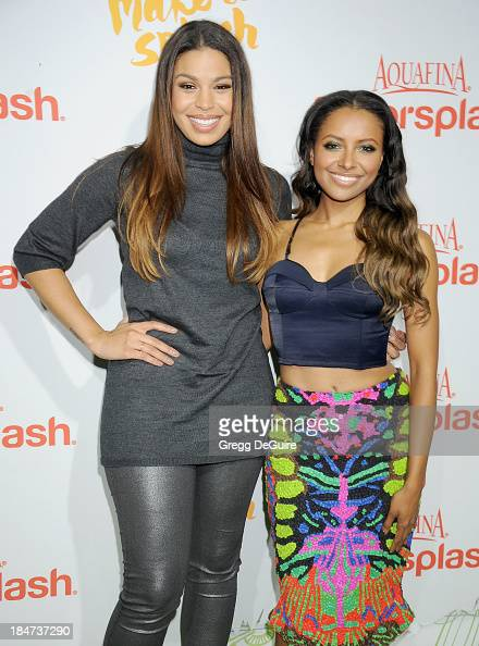 Actress/singer Jordin Sparks and actress Kat Graham arrive at the Aquafina FlavorSplash Launch Party at Sony Pictures Studios on October 15 2013 in...
