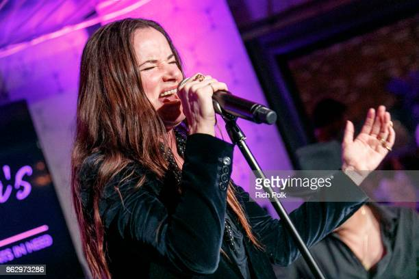 Actress/singer Juliette Lewis performs on stage with the Hellcat Saints at An Evening With Rhonda's Kiss Charity at Beauty Essex on October 18 2017...
