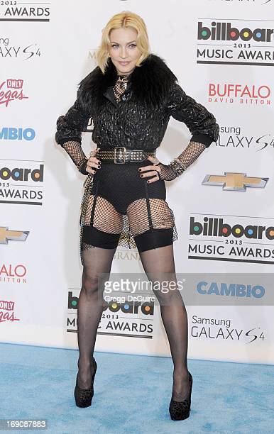 Actress/singer Madonna poses in the press room at the 2013 Billboard Music Awards at MGM Grand Garden Arena on May 19 2013 in Las Vegas Nevada