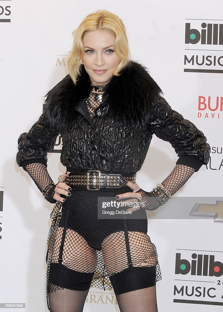 Actress/singer Madonna poses in the press room at the 2013 Billboard Music Awards at MGM Grand Garden Arena on May 19, 2013 in Las Vegas, Nevada.