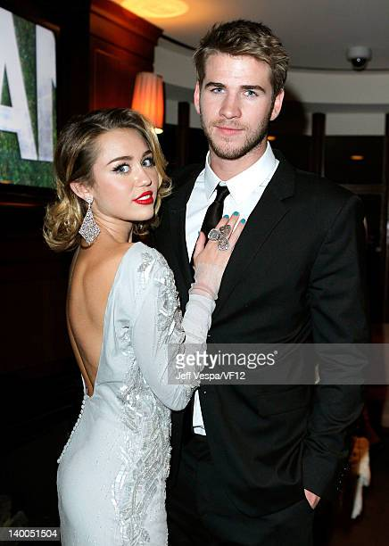 Actress/singer Miley Cyrus and actor Liam Hemsworth attend the 2012 Vanity Fair Oscar Party Hosted By Graydon Carter at Sunset Tower on February 26...