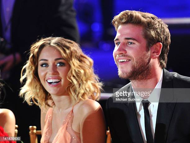 Actress/singer Miley Cyrus and actor Liam Hemsworth in the audience during Muhammad Ali's Celebrity Fight Night XVIII held at JW Marriott Desert...