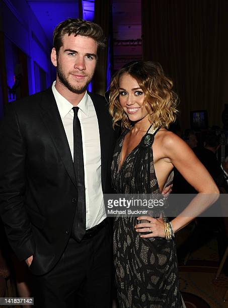Actress/singer Miley Cyrus and Liam Hemsworth backstage during Muhammad Ali's Celebrity Fight Night XVIII held at JW Marriott Desert Ridge Resort Spa...