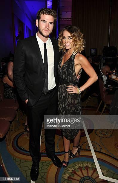 Actress/singer Miley Cyrus and Liam Hemsworth backstage during Muhammad Ali's Celebrity Fight Night XVIII held at JW Marriott Desert Ridge Resort Spa...