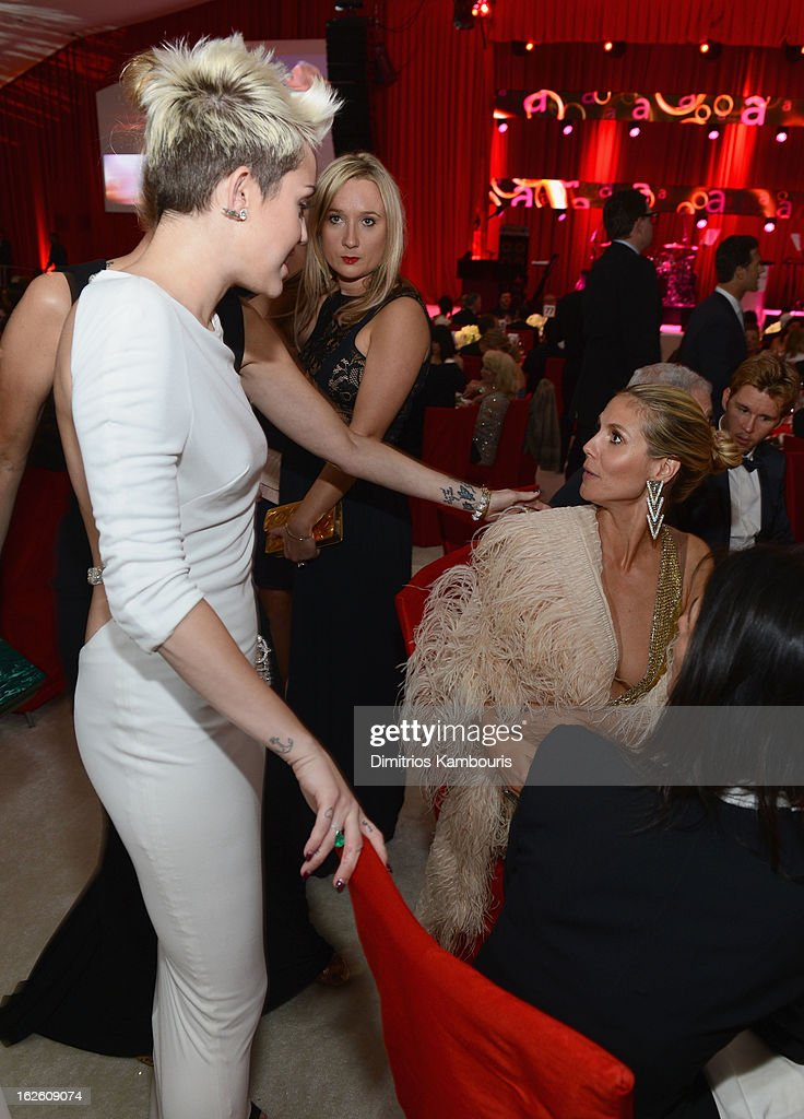 Actress/singer Miley Cyrus and model Heidi Klum attend the 21st Annual Elton John AIDS Foundation Academy Awards Viewing Party at West Hollywood Park on February 24, 2013 in West Hollywood, California.