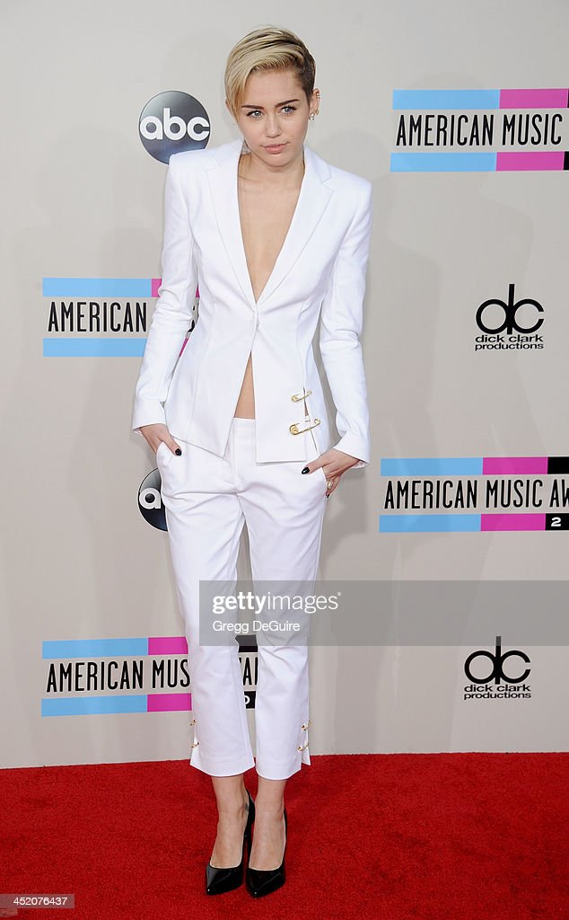 Actress/singer Miley Cyrus arrives at the 2013 American Music Awards at Nokia Theatre L.A. Live on November 24, 2013 in Los Angeles, California.