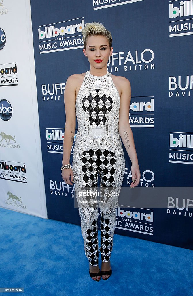 Actress/singer <a gi-track='captionPersonalityLinkClicked' href=/galleries/search?phrase=Miley+Cyrus&family=editorial&specificpeople=3973523 ng-click='$event.stopPropagation()'>Miley Cyrus</a> arrives at the Buffalo David Bitton red carpet at the 2013 Billboard Music Awards at the MGM Grand Garden Arena on May 19, 2013 in Las Vegas, Nevada.