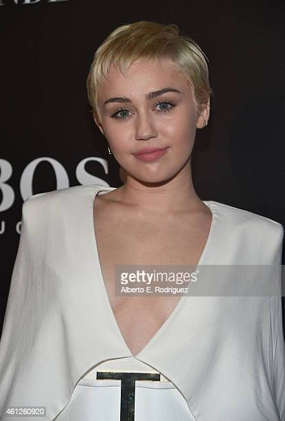 Actress/singer Miley Cyrus attends the W Magazine Shooting Stars Exhibit Opening at Wilshire May Company Building on January 9 2015 in Los Angeles...