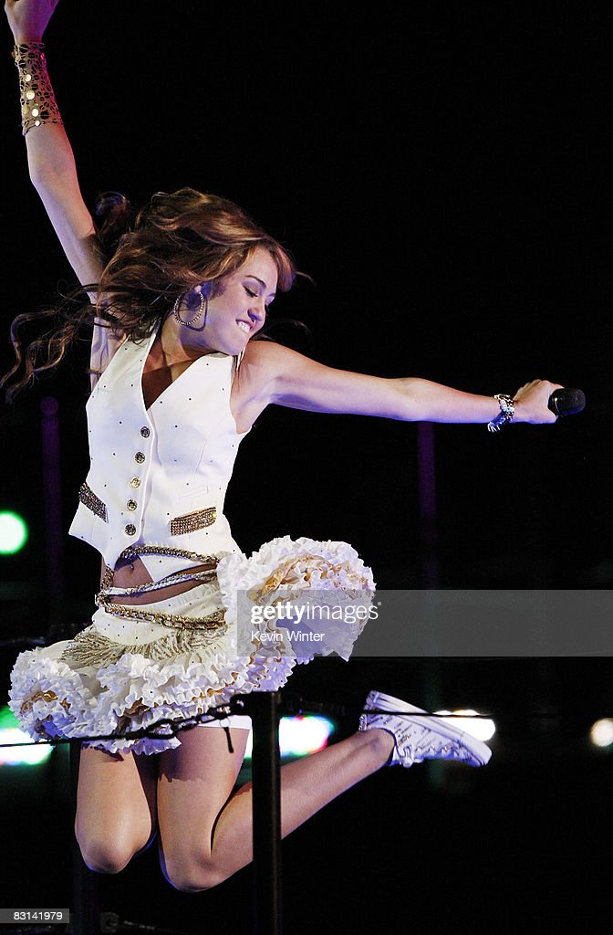 Actress/singer Miley Cyrus performs at her 'Sweet 16' birthday celebration benefiting Youth Service America at Disneyland on October 5, 2008 in Anaheim, California.