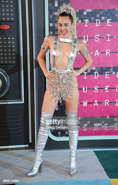 Actress/singer Miley Cyrus styled by Simone Harouche arrives at the 2015 MTV Video Music Awards at Microsoft Theater on August 30 2015 in Los Angeles...