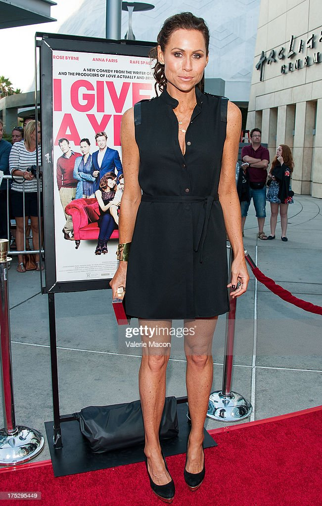 Actress/singer Minnie Driver arrives at the Screening Of Magnolia Pictures' 'I Give It A Year' at ArcLight Hollywood on August 1, 2013 in Hollywood, California.