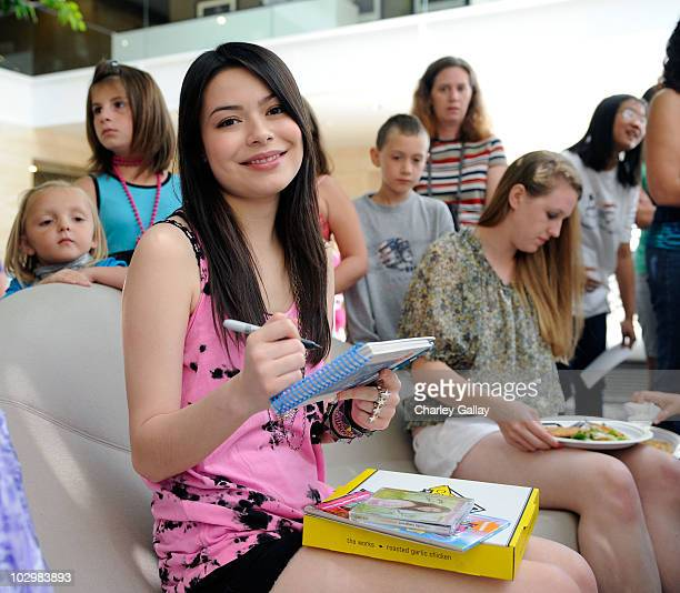 Actress/singer Miranda Cosgrove meets with radio contest winners from across the country at Sony Music Entertainment on July 19 2010 in Los Angeles...