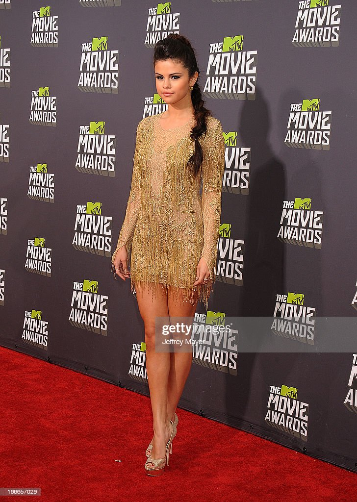 Actress/singer Selena Gomez arrives at the 2013 MTV Movie Awards at Sony Pictures Studios on April 14, 2013 in Culver City, California.
