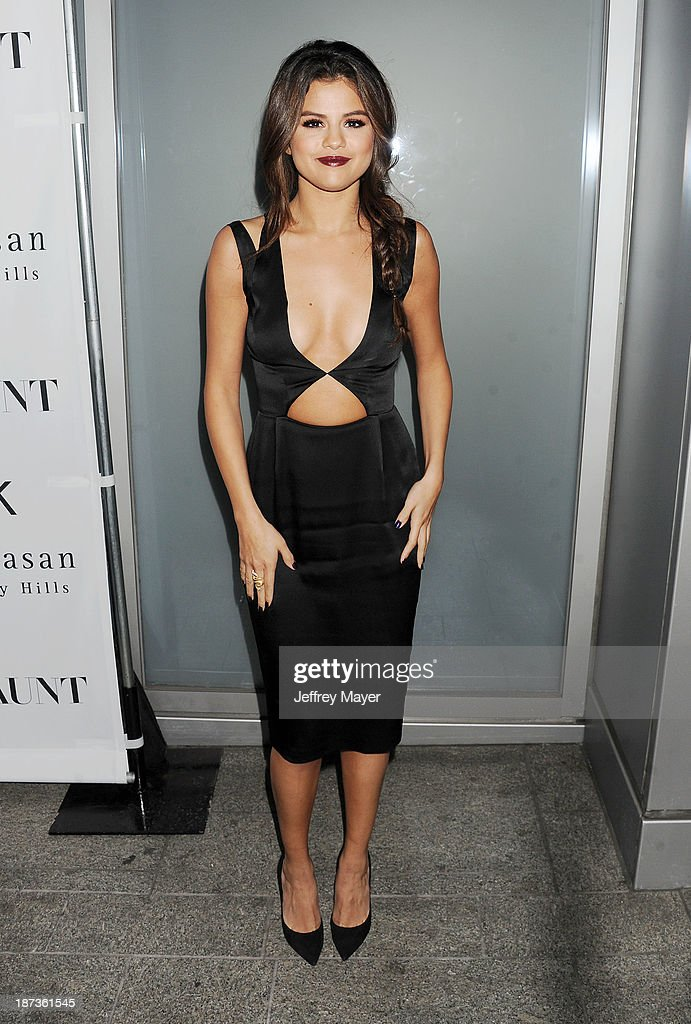 Actress/singer <a gi-track='captionPersonalityLinkClicked' href=/galleries/search?phrase=Selena+Gomez&family=editorial&specificpeople=4295969 ng-click='$event.stopPropagation()'>Selena Gomez</a> attends the Flaunt Magazine Issue Party with <a gi-track='captionPersonalityLinkClicked' href=/galleries/search?phrase=Selena+Gomez&family=editorial&specificpeople=4295969 ng-click='$event.stopPropagation()'>Selena Gomez</a> And Amanda De Cadenet held at Hakkasan Beverly Hills on November 7, 2013 in Beverly Hills, California.