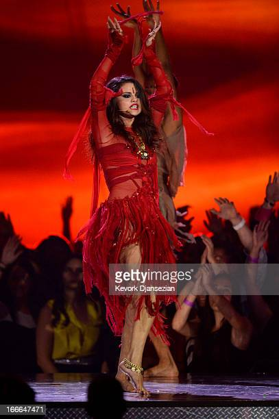 Actresssinger Selena Gomez performs onstage during the 2013 MTV Movie Awards at Sony Pictures Studios on April 14 2013 in Culver City California