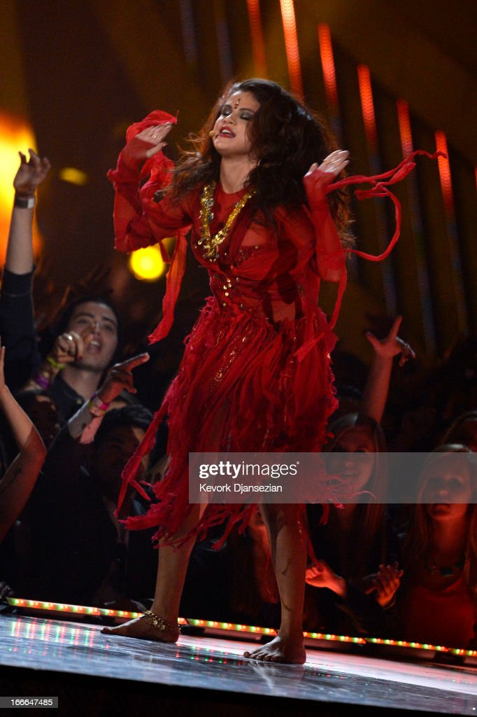 Actress-singer Selena Gomez performs onstage during the 2013 MTV Movie Awards at Sony Pictures Studios on April 14, 2013 in Culver City, California.