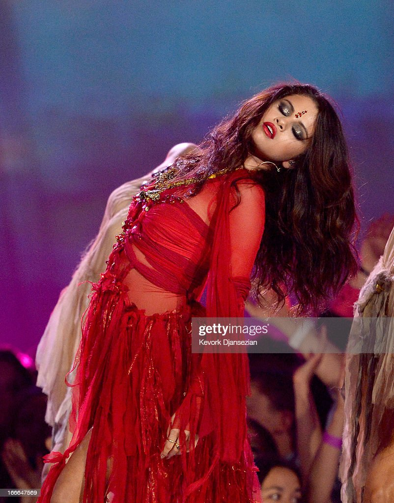 Actress-singer <a gi-track='captionPersonalityLinkClicked' href=/galleries/search?phrase=Selena+Gomez&family=editorial&specificpeople=4295969 ng-click='$event.stopPropagation()'>Selena Gomez</a> performs onstage during the 2013 MTV Movie Awards at Sony Pictures Studios on April 14, 2013 in Culver City, California.