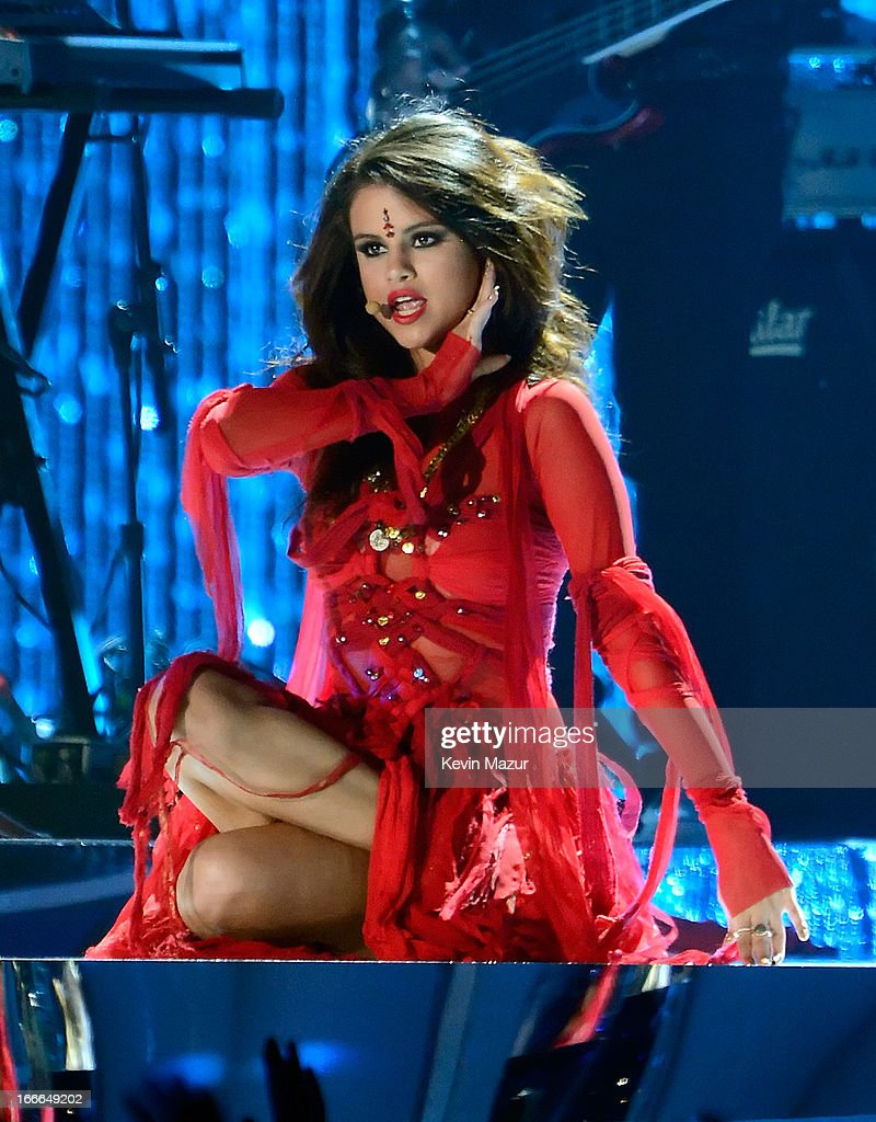 Actress/singer Selena Gomez performs onstage during the 2013 MTV Movie Awards at Sony Pictures Studios on April 14, 2013 in Culver City, California.