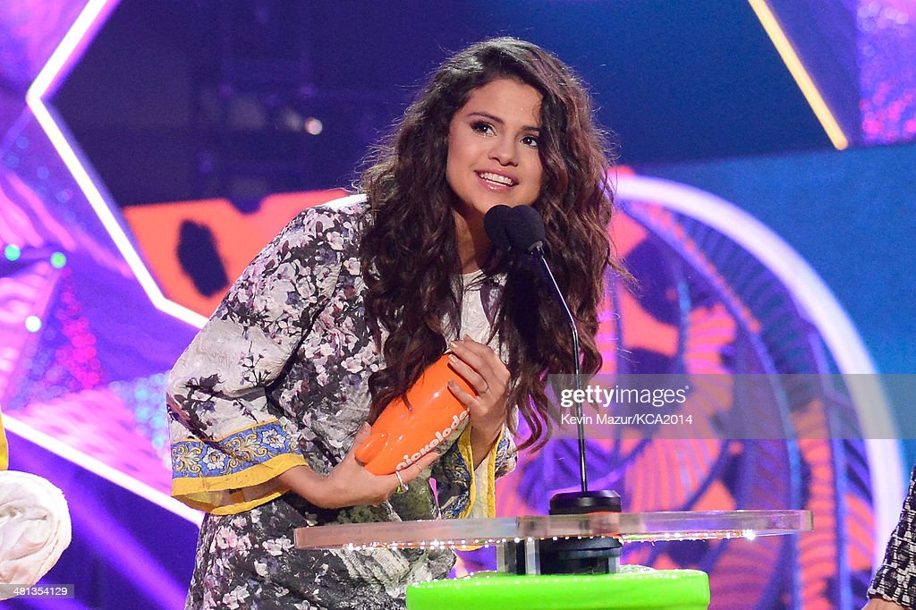 Actress/singer Selena Gomez speaks onstage during Nickelodeon's 27th Annual Kids' Choice Awards held at USC Galen Center on March 29, 2014 in Los Angeles, California.