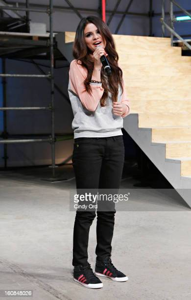 Actress/singer Selena Gomez speaks to the audience at the end of the adidas NEO Label fall 2013 fashion show during MercedesBenz Fashion Week on...