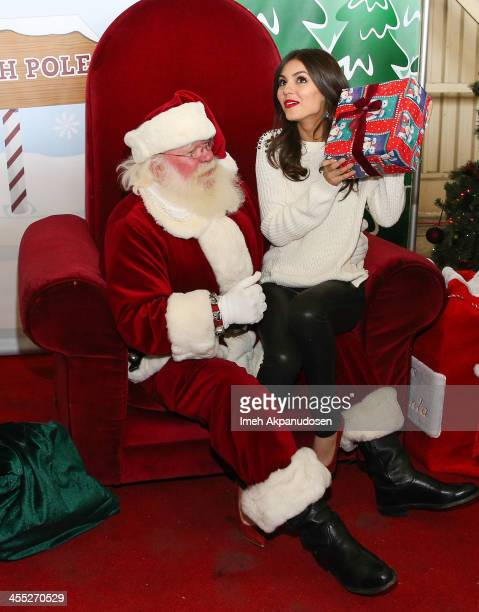 Actress/singer Victoria Justice attends a 'Holiday Flight To The North Pole' hosted by Delta Air Lines at LAX Airport on December 11 2013 in Los...