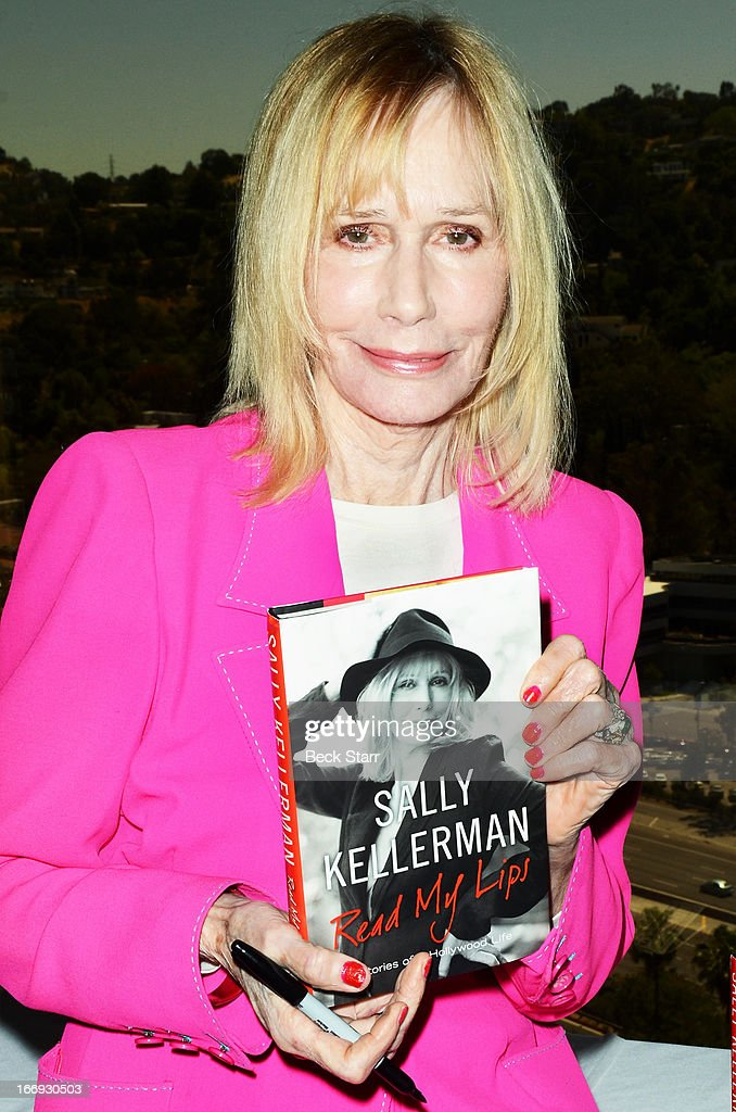 Actress/singer/author <a gi-track='captionPersonalityLinkClicked' href=/galleries/search?phrase=Sally+Kellerman&family=editorial&specificpeople=207185 ng-click='$event.stopPropagation()'>Sally Kellerman</a> signs copies of her book 'Read My Lips, Stories of a Hollywood Life' after being honored at The Hollywood Chamber Of Commerce 92nd Annual Installation & Lifetime Achievement Awards luncheon at Sheraton Universal on April 18, 2013 in Universal City, California.