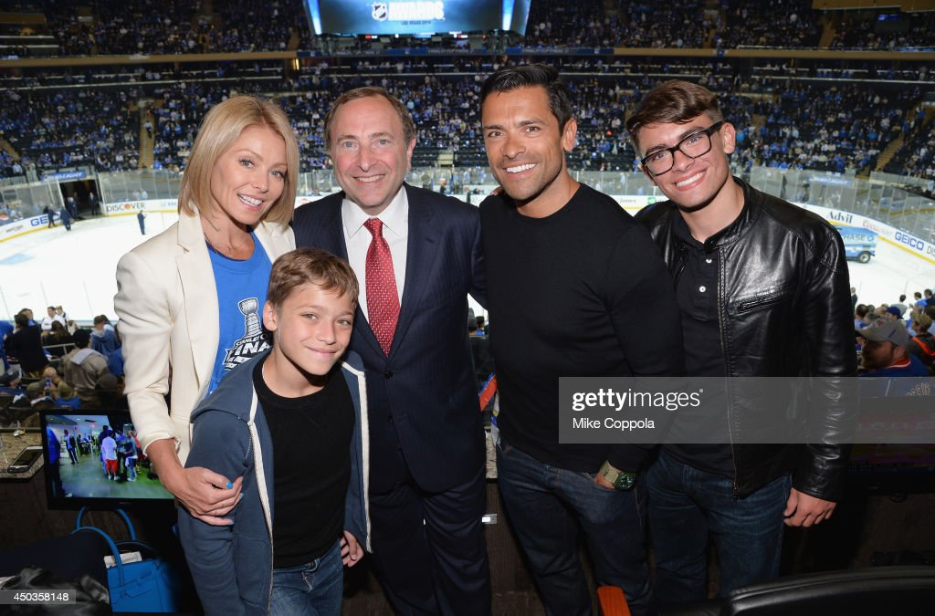 Actress/talk show host <a gi-track='captionPersonalityLinkClicked' href=/galleries/search?phrase=Kelly+Ripa&family=editorial&specificpeople=202134 ng-click='$event.stopPropagation()'>Kelly Ripa</a>, Joaquin Antonio Consuelos, Commissioner of the National Hockey League <a gi-track='captionPersonalityLinkClicked' href=/galleries/search?phrase=Gary+Bettman&family=editorial&specificpeople=215089 ng-click='$event.stopPropagation()'>Gary Bettman</a>, Actor <a gi-track='captionPersonalityLinkClicked' href=/galleries/search?phrase=Mark+Consuelos&family=editorial&specificpeople=234398 ng-click='$event.stopPropagation()'>Mark Consuelos</a>, and Michael Joseph Consuelos attends game 3 of the 2014 NHL Stanley Cup Final at Madison Square Garden on June 9, 2014 in New York City.