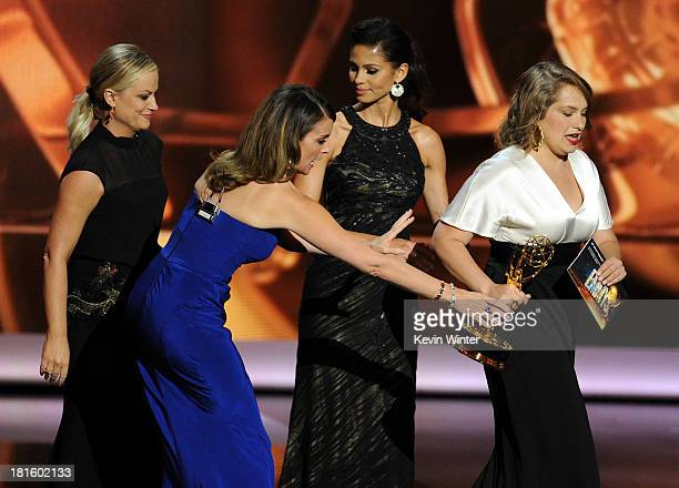 Actress/writers Amy Poehler and Tina Fey and Winner for Supporting Actress in a Comedy Series Merritt Wever speak onstage during the 65th Annual...