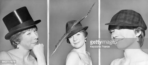 L'actrice américaine Shirley MacLaine essaie divers chapeaux d'homme chez un chapelier parisien le 29 février 1960 à Paris France