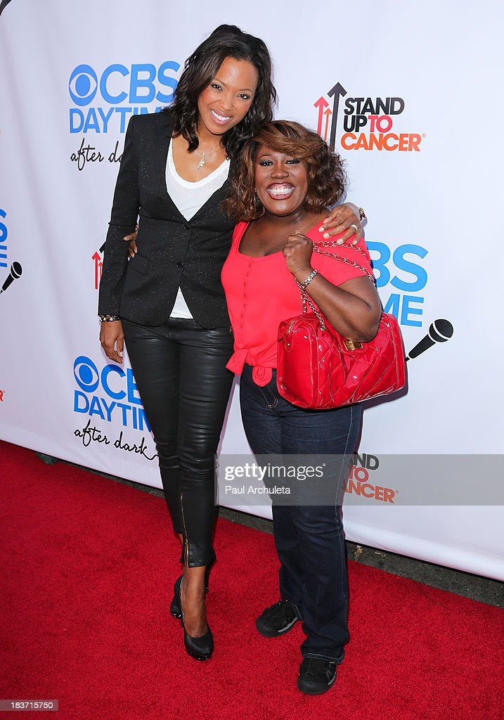 Actrors Aisha Tyler (L) and Sheryl Underwood attend the CBS After Dark with an evening of laughter benefiting Stand Up To Cancer at The Comedy Store on October 8, 2013 in West Hollywood, California.
