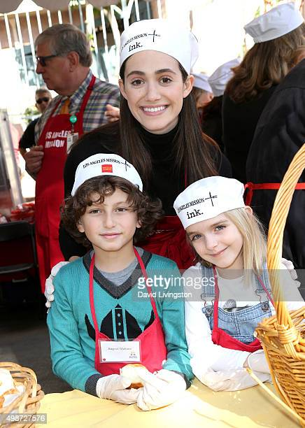 Actrors Emmy Rossum August Maturo and Mckenna Grace attend Thanksgiving for the Homeless at the Los Angeles Mission on November 25 2015 in Los...