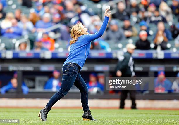 Actrss Edie Falco throws out the ceremonial first pitch of a game between the New York Mets and the Atlanta Braves at Citi Field on April 23 2015 in...