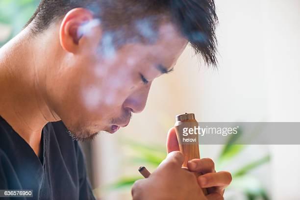 Acupuncturist preparing moxa burning treatment