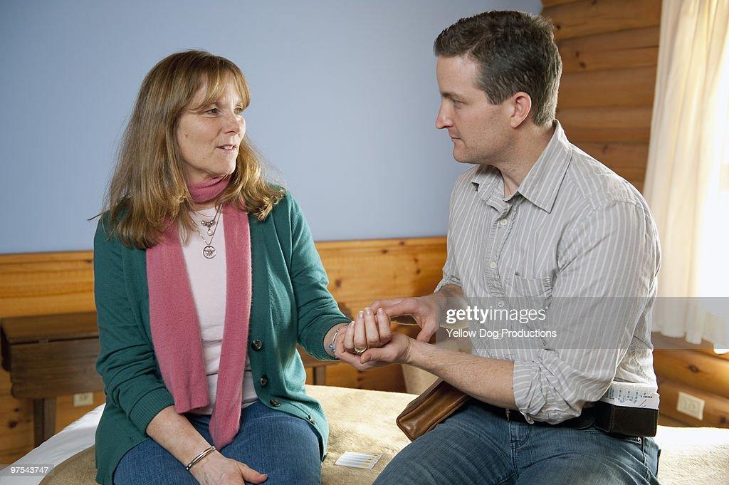 Acupuncturist taking patient's pulse