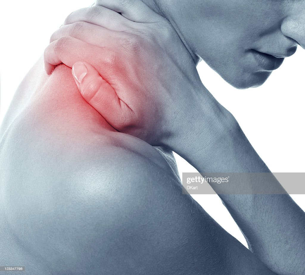 Acute pain in a neck at the young women. : Stock Photo