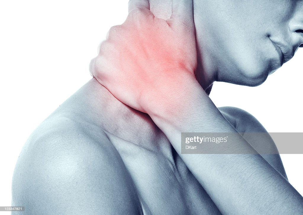Acute pain in the neck of a young woman : Stock Photo