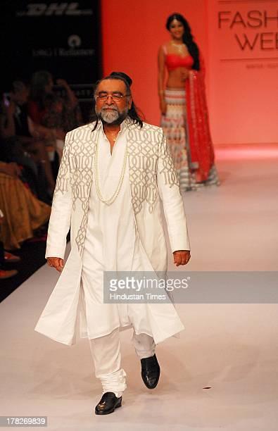 Ad guru Prahlad Kakkar donned a greywhite sherwani kurta and churidar as he took to the ramp for designer Shravan Kumar during the Lakme Fashion Week...