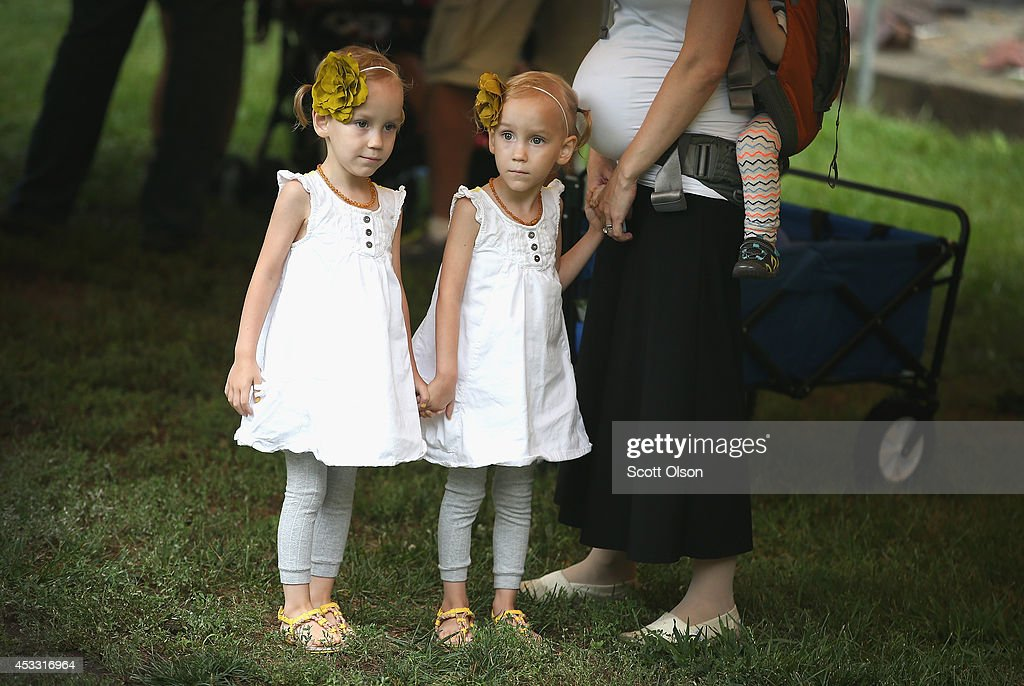 Ada and Evie Roberts wait to compete in the twins lookalike competition at the Iowa State Fair on August 7 2014 in Des Moines Iowa The competition...