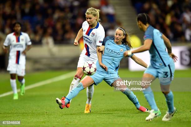 Ada Hegerberg of Lyon Kosovare Asllani of Manchester during the Women's Champions League match between Olympique Lyonnais and Manchester City at...